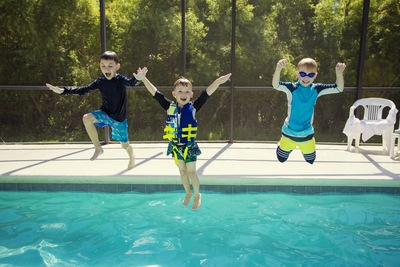 Pool Enclosures Keep Fun in and Elements Out